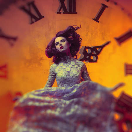 Young woman on clock background.