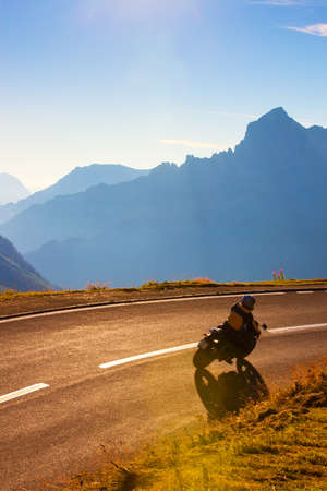 day trip: Alps mountains road with motorcyclist