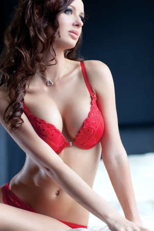 Young sexy woman in red lingerie portrait. photo