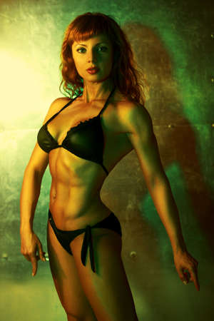 Young sports woman  Vibrant green colors  photo