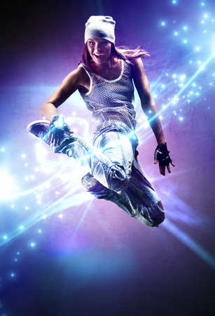 Young woman dancer with lights traces and sparks.