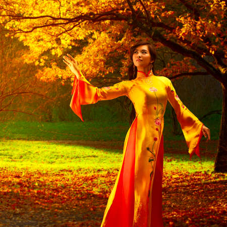 Young vietnamese woman in autumn park. photo
