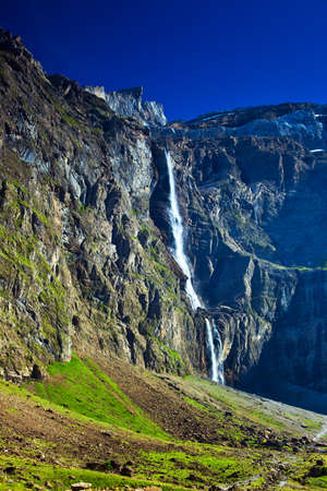 Waterfall in high mountains in Pyrenees  photo