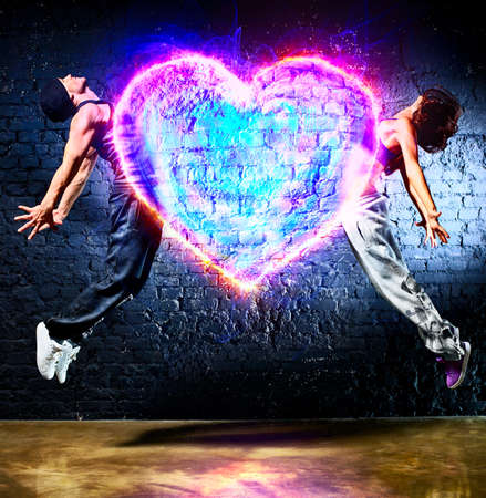 Young couple jumping to heart symbol  Stock Photo