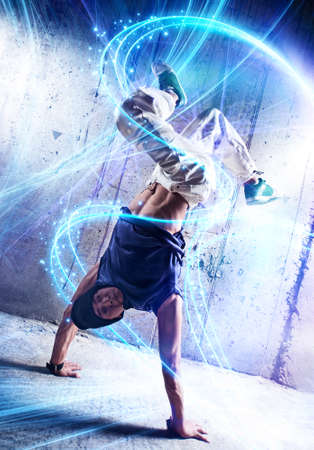light traces: Young man break danceing on wall background  Stock Photo