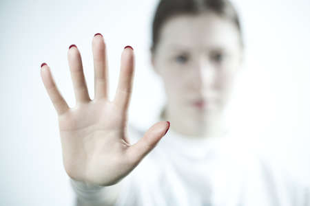 handsign: Young woman showing palm handsign