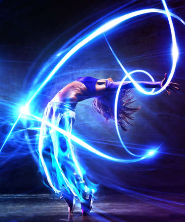 hip hop dancing: Young woman dancer  With light effects  Stock Photo