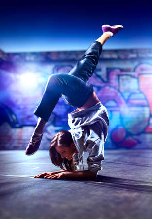Young woman dancer on urban background  photo