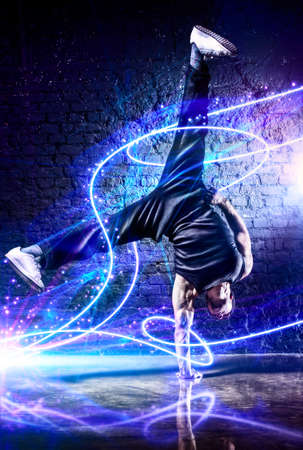 light traces: Young strong man break dance  With light effects  Stock Photo