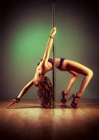 poles: Young slim pole dance woman