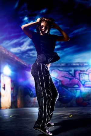 Young woman dancer on urban background. photo