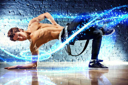 urban dance: Young dancing man with light effects