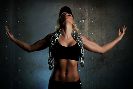 Young sports woman with heavy chain. photo
