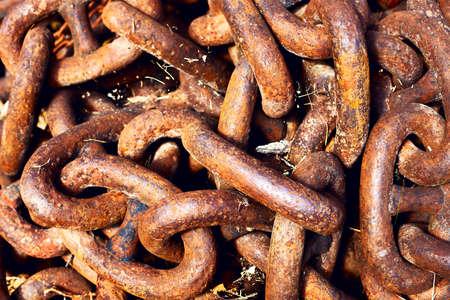 rusty chain: Heavy red rusty metallic chain.