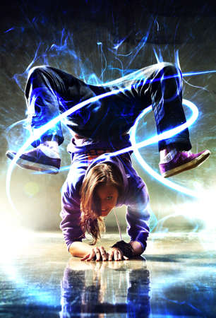 hand on hip: Young woman modern dancer. With lights and glow energy effect. Stock Photo