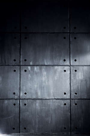 contrast: Gray concrete wall with big blocks in contrast dark colors Stock Photo