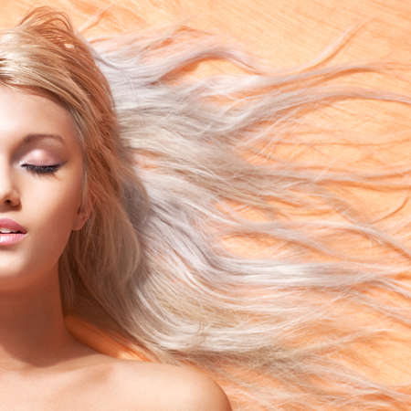 blond hair: Young woman with long blond hair portrait. Half face composition.
