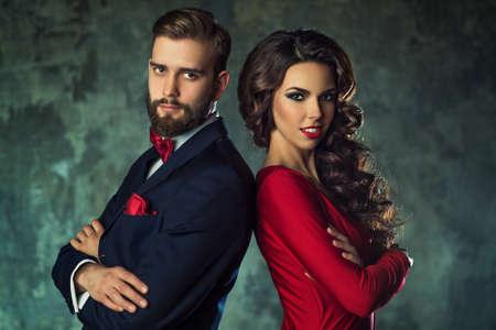 Young elegant couple in evening dress portrait. Standing shoulder to shoulder.
