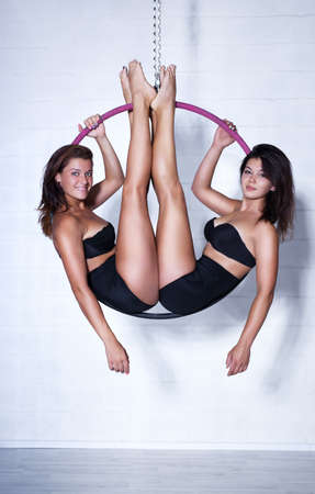 slim women: Two young slim sports women on ring.
