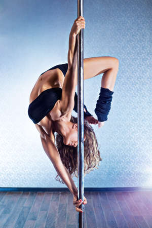 Young slim sexy pole dance woman in black lingerie. photo