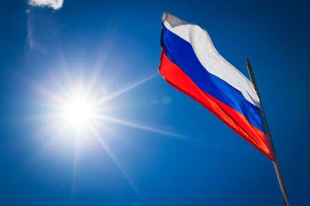 Russian flag on blue sky background Banco de Imagens