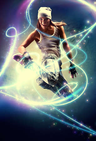 Young woman dancer. With lights traces and sparks effects. photo