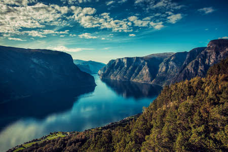 Norway fjord landscape on sunset. Contrast film style colors.
