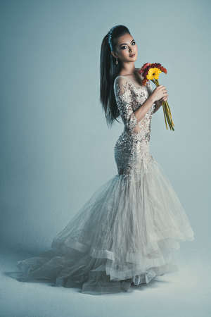 Young asian woman in dress with flowers fashion portrait photo