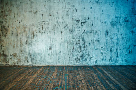 stone wall: Stone wall and wooden floor background. Blue and red color tinting. Stock Photo
