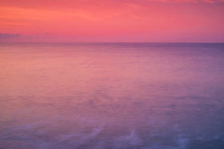 colores calidos: Soft warm colors abstract background with sea and sky at sunset. Calm and romantic mood. Foto de archivo