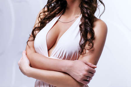 Young sexy brunette woman body in white dress photo
