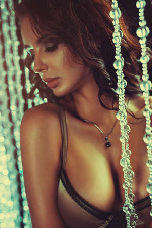 Young sexy brunette woman looking aside portrait. Vintage film style colors effect. photo