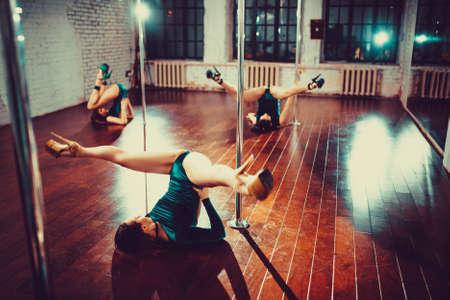 beautiful nude woman: Three sexy slim women team pole dance training in dance hall