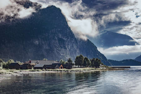Norway fjord dramatic landscape with mountains, water and buildings