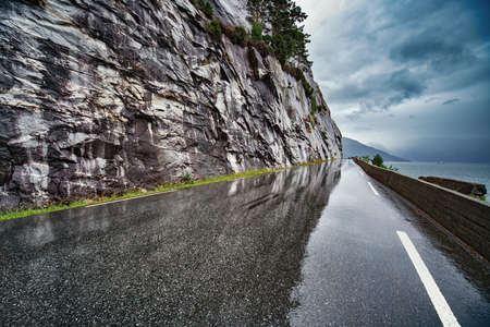 rain wet: Wet road after rain in Norway. Car driving safety concept. Stock Photo