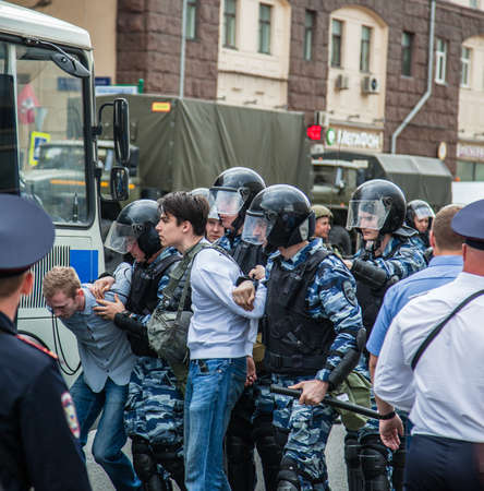 corrupt: 12 June 2017. Russia. Moscow. Tverskaya st. Meeting organized by Alexei Navalny against corruption in  government. Heavy armored police forces arrest young people. Editorial