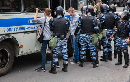 12 June 2017. Russia. Moscow. Tverskaya st. Meeting organized by Alexei Navalny against corruption in  government. Heavy armored police forces arrest young people. Editorial