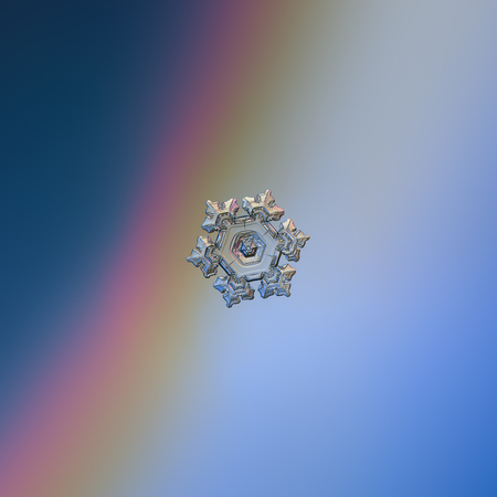 Snowflake glittering on smooth gradient background.