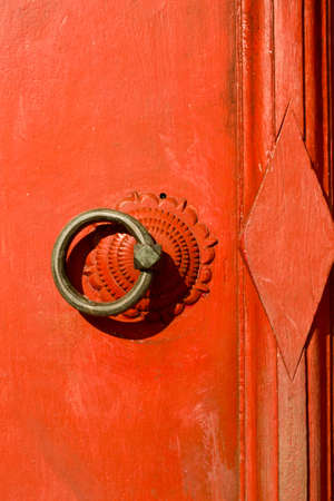knocker on the thai traditional red door