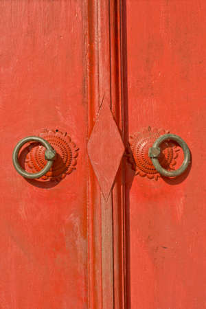 knocker on the thailand traditional red door