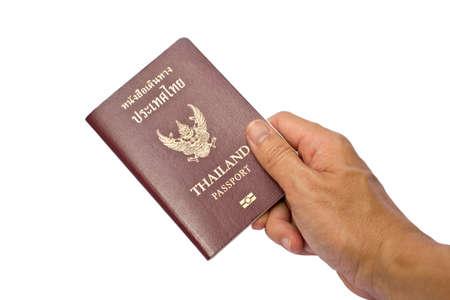 holding a Thailand passport. Stock Photo