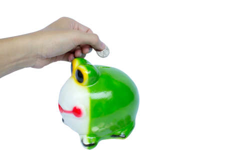 a-hand-saving-coin-in-frog Stock Photo