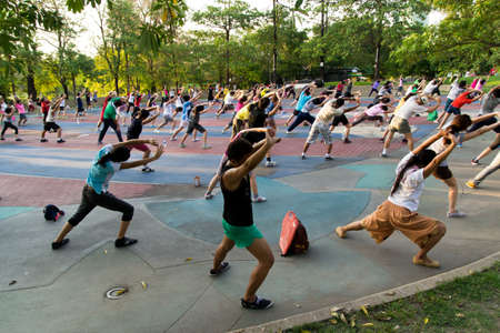 BANGKOK - APRIL 21   Unidentified people take part in dance aerobics in ROT FAI Park on April 21, 2013 in Bangkok, Thailand  Aerobics is a popular fitness activity in SE Asia, often held in public parks