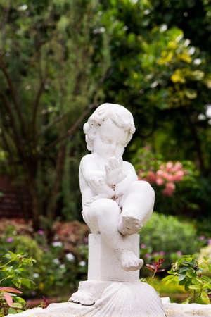 Beautiful Cherub statue profile in the Garden Stock Photo