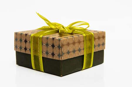 Green box yellow bow and ribbon