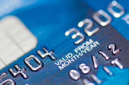 Closeup image of blue credit card Editorial