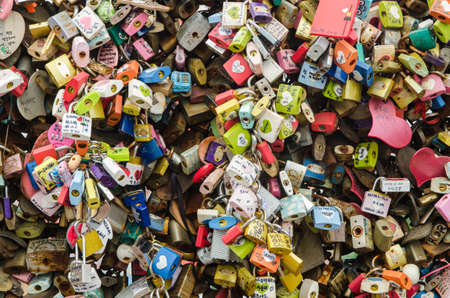 Seoul, South Korea - JUNE 21, 2014  Thousands of love padlocks at N Seoul Tower  Locks of love is a custom in some cultures which symbolize their love will be locked forever, Seoul South Korea