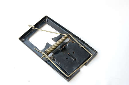 elimination: Old Metal mousetrap on a white background