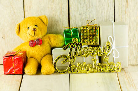 Seated teddy bear with gift