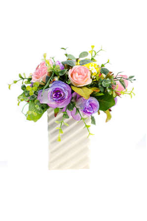 Artificial rose flowers in green vase on white background